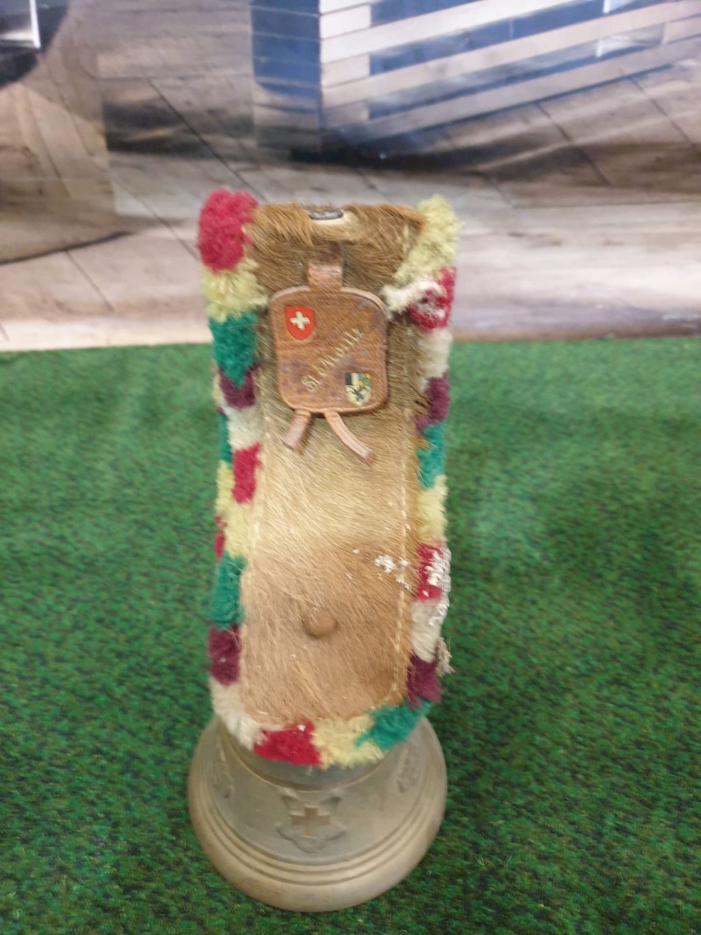 A Swiss bronze 'Glocken' style cow bell. The bell cast with flowers and the arms of Switzerland, the