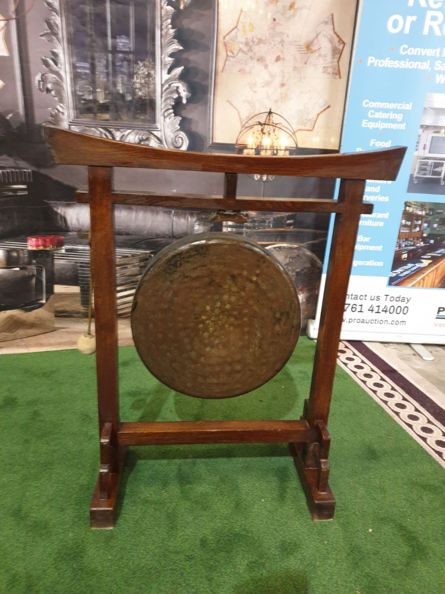 An Oriental brass gong on wooden stand An oriental, possibly Chinese circular hammered brass gong on - Image 2 of 6