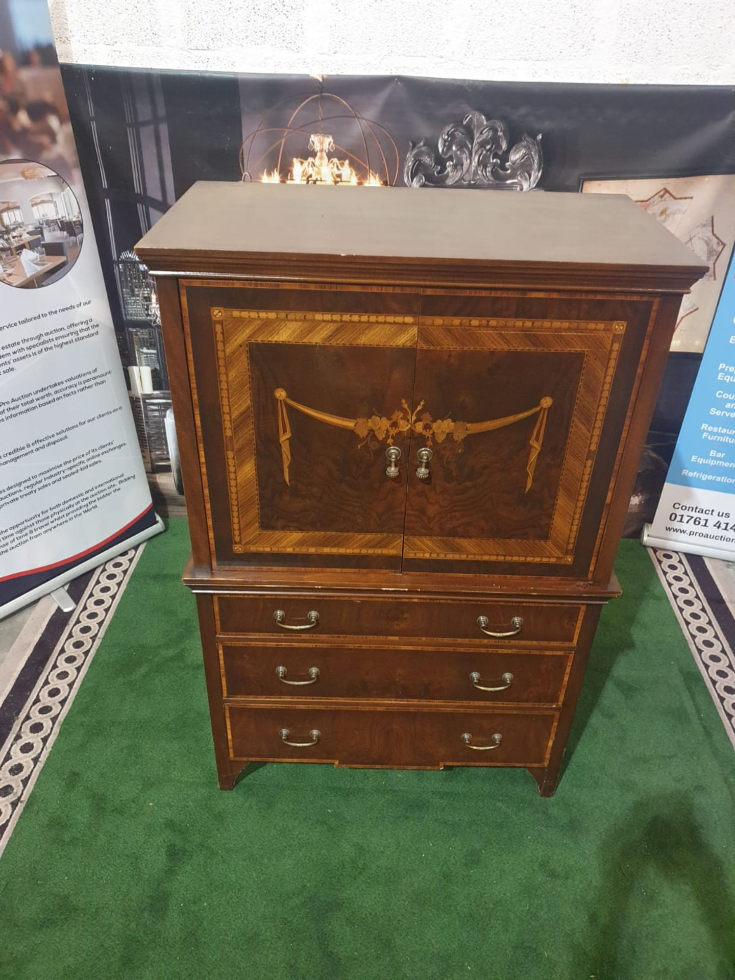 A Georgian style reproduction TV cabinet with three drawers under in mahogany veneers with a classic