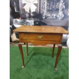Georgian walnut single drawer side table The table has a single oak lined drawer that has a cock