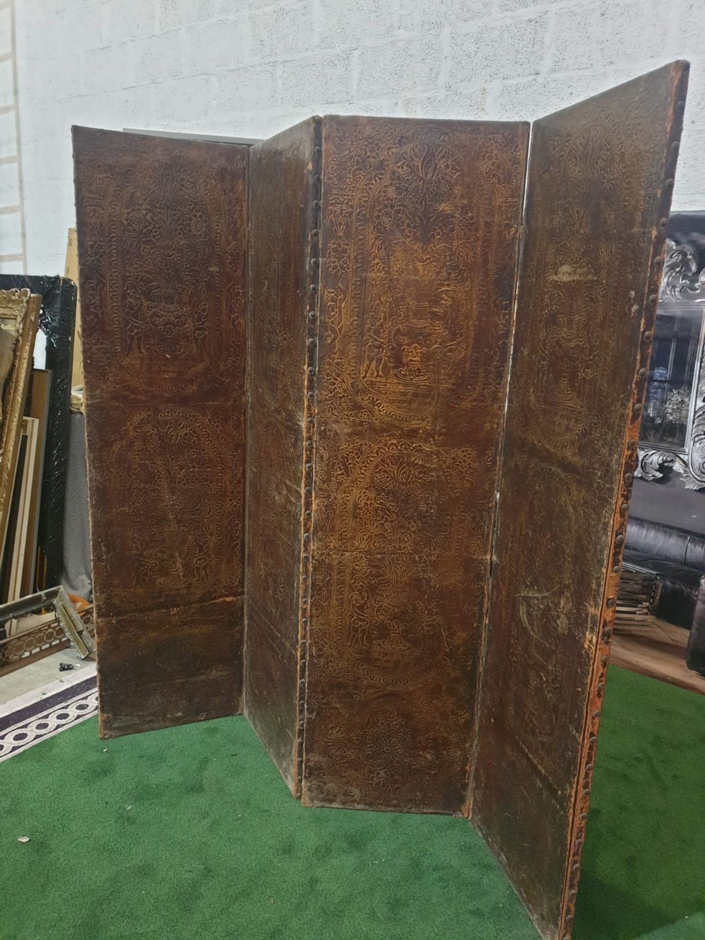 A 17th century style leather covered four fold screen, probably Spanish. Each fold covered in two - Image 3 of 3