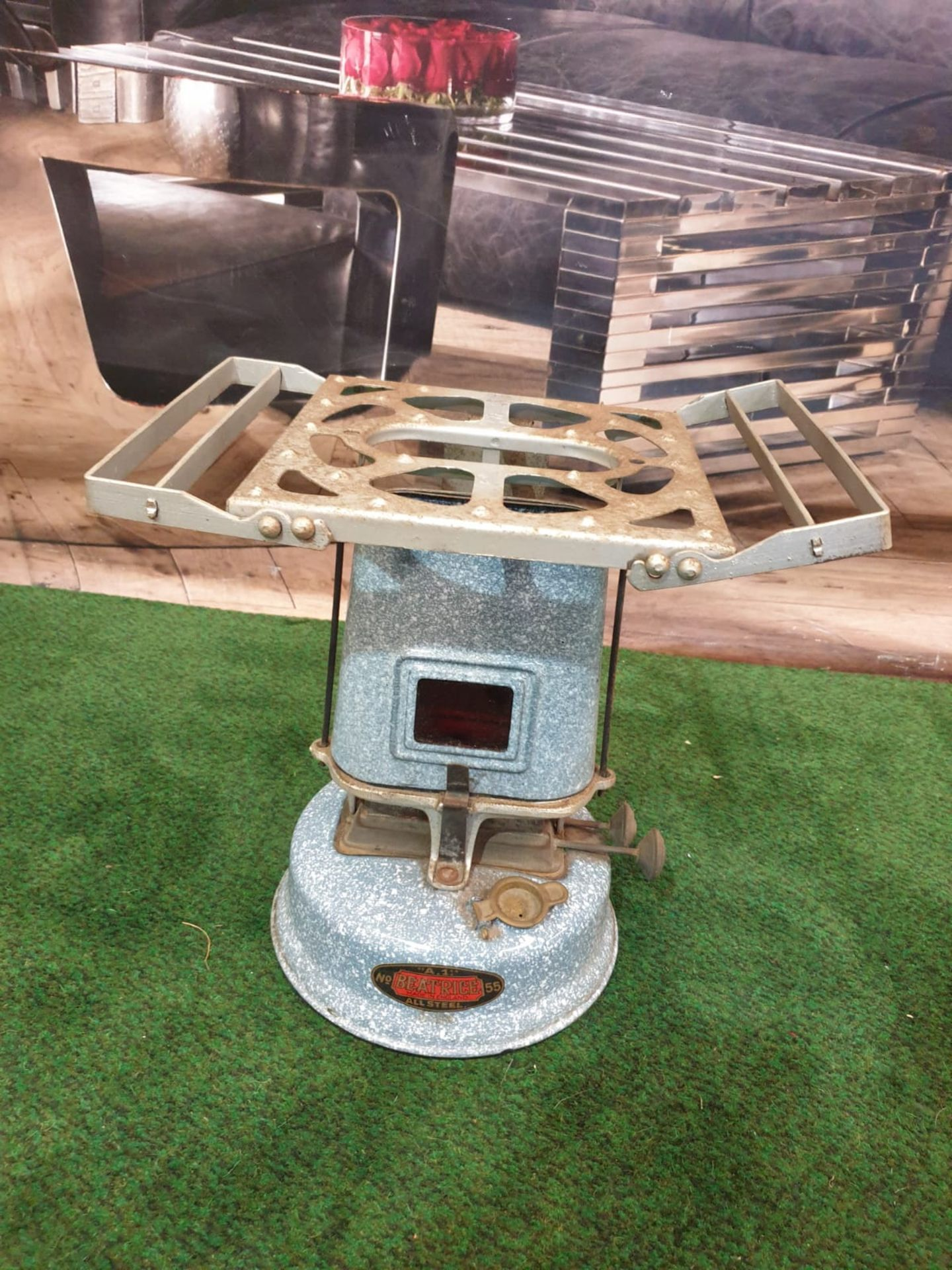 A Beatrice No.55 oil travel stove enamel cooker, paraffin driven, with circular tank at base, and
