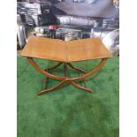 A polished mahogany folding table 76 x 43 x 49cm (Nb bar latch missing)