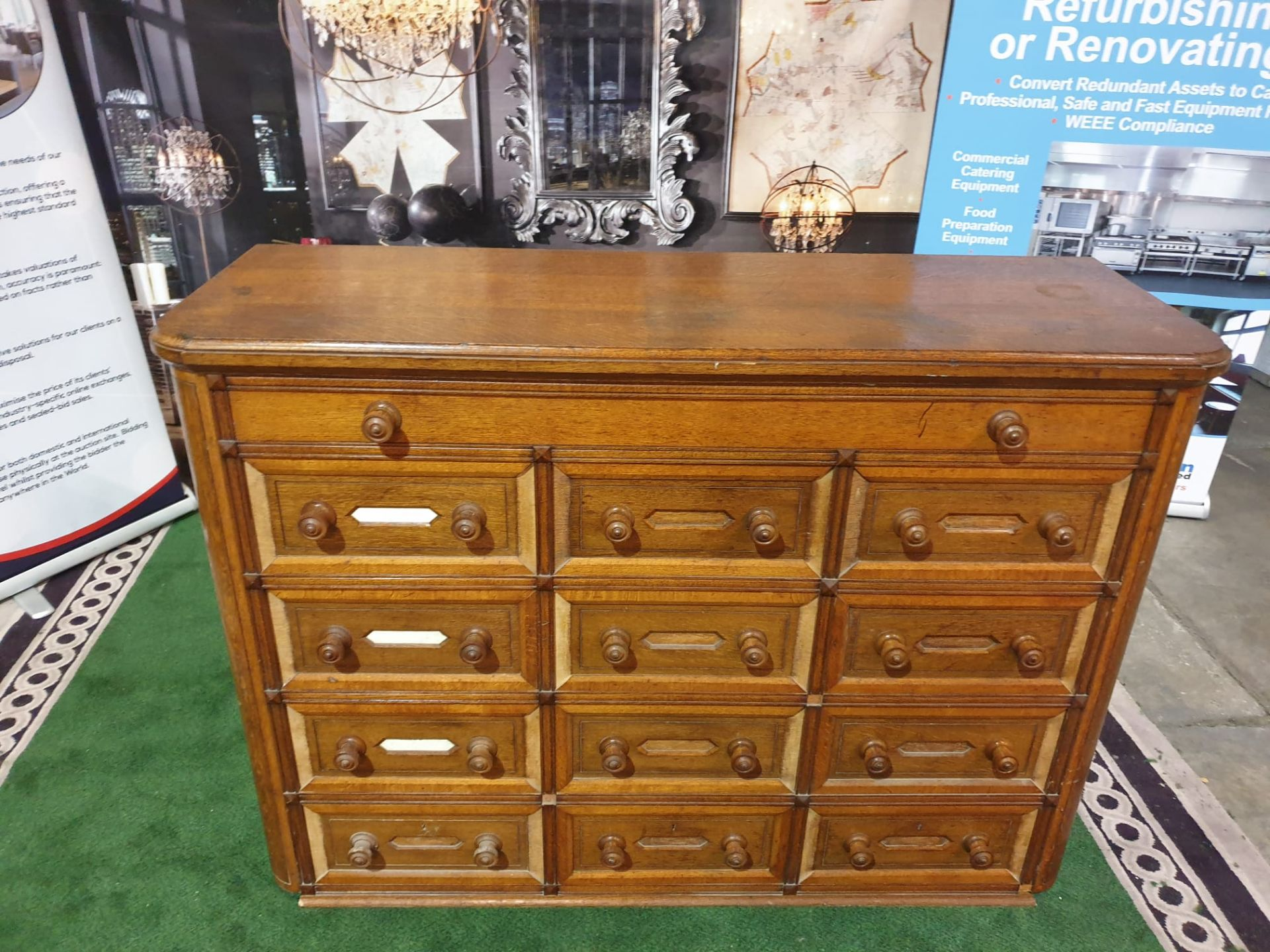 A Victorian oak office chest of drawers. With rounded corners and panelled sides, the top long - Image 2 of 4
