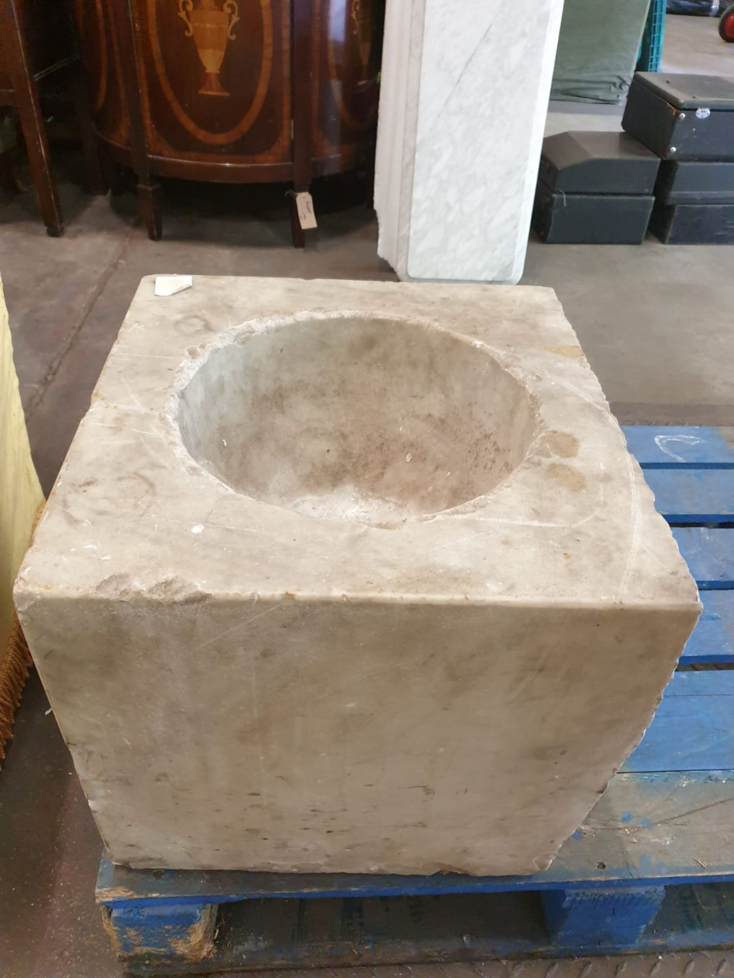 A marble square font with bowl scooped out 46 x 44 x 39cm