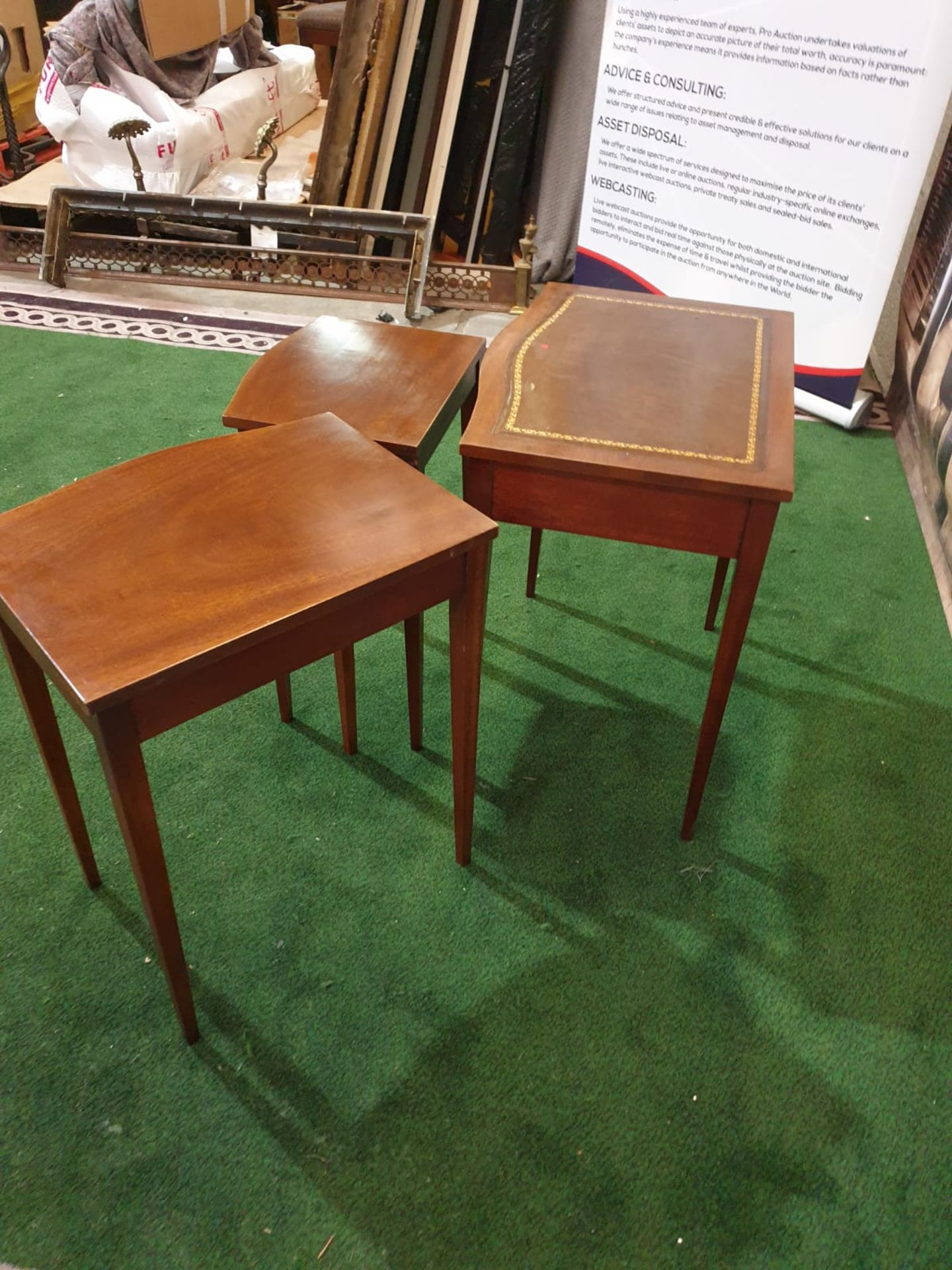 A nest of three mahogany bow front tables in the George III style. The largest table with a gilt - Image 4 of 5