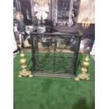 A cast metal fire guard with a pair of Brass Fire Andirons Ornate yet simple and elegant design in
