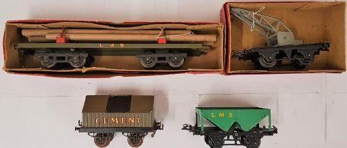 "Four Hornby ""0"" Gauge Vehicles - No. 2 Lumber Wagon; No.1 Crane Truck; Cement Wagon; and Hopper"