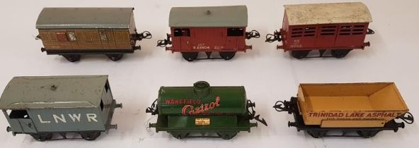 Collection of Six Hornby Wagons including Wakefield Castrol Motor Oil, L.N.E.R. and Trinidad Lake