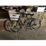 Vintage grocers bicycle with wicker basket