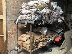 Angle iron rack and contents of hessian sacks, Hovis floor mats, seed corn bags
