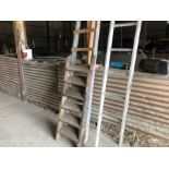 2 wooden ladders