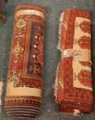 2 PATTERNED RED RUGS - 1 BEING 3ft 6'' X 2ft 6'' & THE OTHER 9ft X 2ft 6''