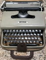 PORTABLE CASED TYPEWRITER BY OLIVETTI