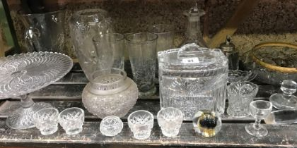 SHELF OF MIXED GLASSWARE INCL; DECANTERS, BISCUIT BARRELS & CHANDELIER FITTING
