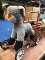 A DEANS CHILD PLAY TOY OF A DONKEY ON 4 WHEELS A/F