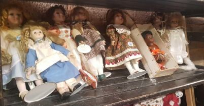 SHELF OF MISC PORCELAIN DOLLS ON STANDS & 1 OTHER PLASTIC IN BOX