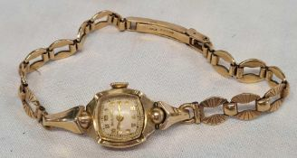 LADIES VINTAGE BULOVA WRIST WATCH WITH 10K GOLD FILLED MARK ON BACK AND 375 GOLD MARK ON STRAP TOTAL