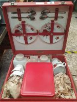 A BREXTON PICNIC SET IN RED CARRY CASE