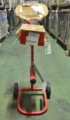 Pallet strapping trolley