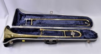 Selmer Bundy Trombone with Case. Obvious dents.