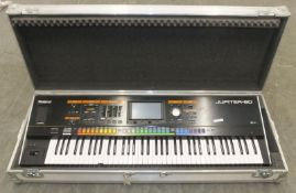 Roland Jupiter-80 Keyboard/Synthesiser in flight case (one key out of place and no handle)