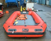 Red inflatable with Mercury 9.9 outboard engine on stand - IF10201FA serial 0R533676, fuel can