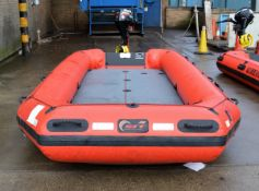 Red inflatable with EPA 2006 standard Suzuki four stroke outboard engine on stand - DF9.9