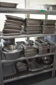 Four tier kitchen storage rack with contents, contents to include- Various stainless steel
