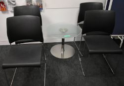 Small glass table accompanied by 4 x chairs