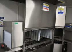 Hobart flight dishwasher with tray conveyor, model- CNA-EW. Please note the tray feeding s