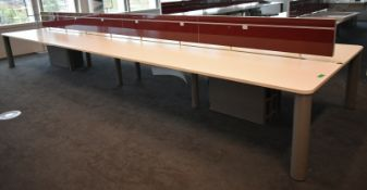 Bank of desks, seating 12, L 6500mm x W 1800mm x H 1180mm, buyer to dismantle and remove