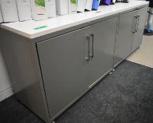 Four door storage cupboard, L 2000mm x W 600mm x H 750mm