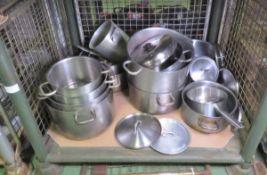 Various Sizes Of Saucepans, Lids