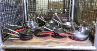 Various Frying Pans Plate Holders Baking Trays Knives