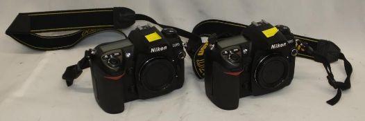 2x Nikon D200 camera bodies - serials 8016544, 8024837 - no batteries, no cards