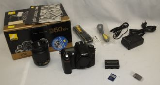 Nikon D50 camera body - serial 7418227 - 1x Battery, 1x charger, 1x 512MB memory card and more