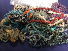 A mixed lot of glass, polished stone and coral bead necklaces (a lot)