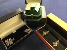 Three sets of gentleman's silver sleevelinks in presentation cases including Simon Carter of