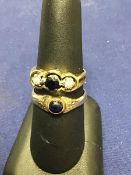 A 15ct gold sapphire and diamond ring, the central sapphire flanked by two diamonds (L/M),