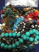 A bag containing a mixed lot of beads and pendants including turquoise, polished stones, mother of