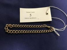 A yellow metal curb link bracelet with dog clip fastener, unmarked (16.4g)