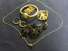 A mixed lot comprising a Scottish white metal pebble brooch, a pair of jet style earrings, a lady'