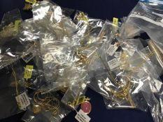 A mixed lot of modern gilt metal neckchains, bracelets, pendants etc., many set with stones,