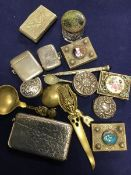 A mixed lot comprising a silver card case and vesta case, a metal vesta case and a silver circular