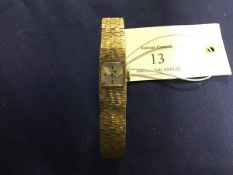 A lady's Accurist 9ct gold wristwatch and strap (26.1g)