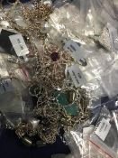 A bag containing a large quantity of white metal chains, pendants, necklaces, predominantly marked