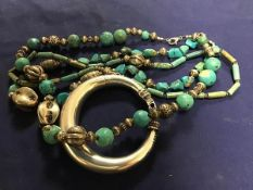 A mixed lot comprising three strands of turquoise and white metal beads, together with a white metal