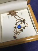 A 9ct gold Edwardian lady's pendant set blue stones and pearls, on 9ct chain (5.2g)