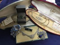 A mixed lot including two cased sets of pearl beads, a marcasite necklace, brooches, bar brooches (a